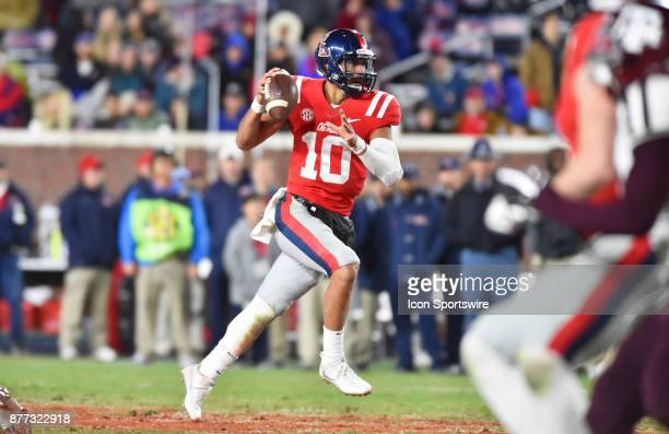 Mississippi Rebels quarterback Jordan Ta'amu looks downfield as he picks up extra yards during the fourth quarter of a NCAA college football game...