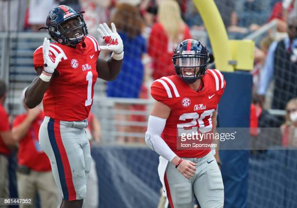 Mississippi Rebels quarterback Shea Patterson celebrates with receiver AJ Brown after his first quarter touchdown during a college football game...