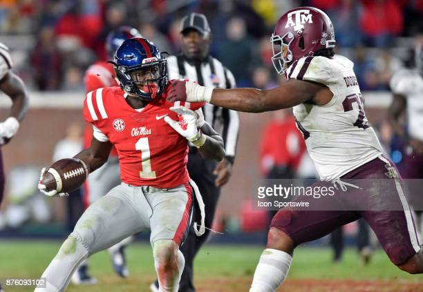 Mississippi Rebels receiver AJ Brown looks to get around a Texas AM Aggies defender during the third quarter of a NCAA college football game on...