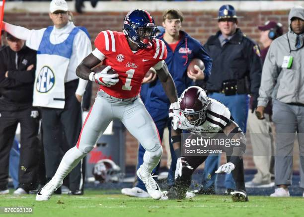 Mississippi Rebels receiver AJ Brown tries to avoid a Texas AM Aggies defender after making a catch during the first quarter of a NCAA college...