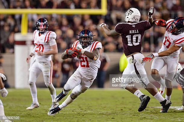 Mississippi Rebels running back Akeem Judd runs toward Texas AM Aggies defensive lineman Daeshon Hall during the Ole Miss Rebels vs Texas AM Aggies...