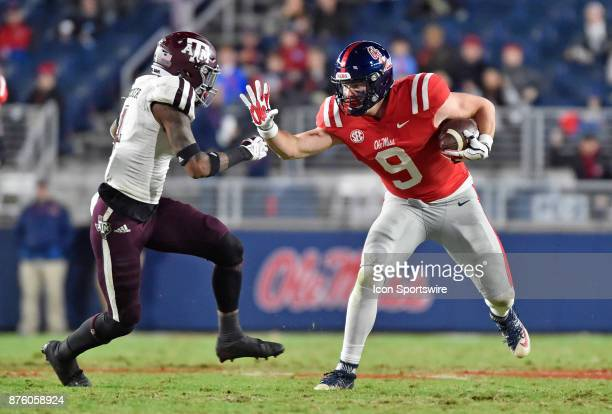 Mississippi Rebels tight end Dawson Knox looks to avoid a Texas AM Aggies defender after making a catch during the second quarter of a college...