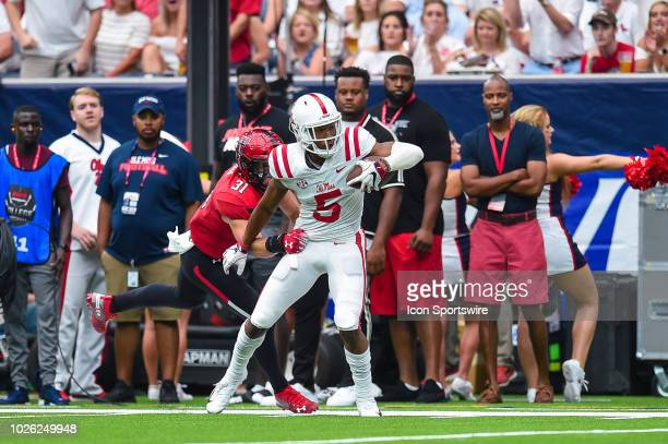 Mississippi Rebels wide receiver DaMarkus Lodge fights through a tackle during the AdvoCare Kickoff college football game between the Texas Tech Red...
