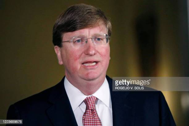 Mississippi Republican Gov. Tate Reeves delivers a televised address prior to signing a bill retiring the last state flag with the Confederate battle...