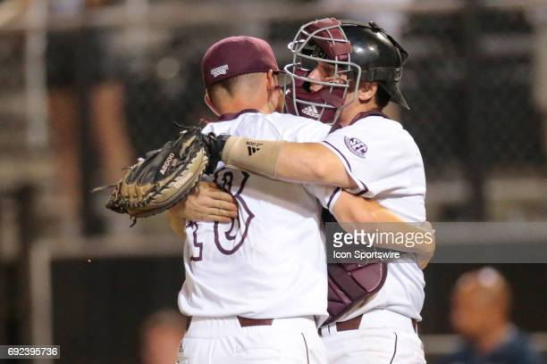Mississippi St pitcher Peyton Plumlee and catcher Josh Lovelady celebrate a victory during an NCAA Division I Regional baseball game between the...