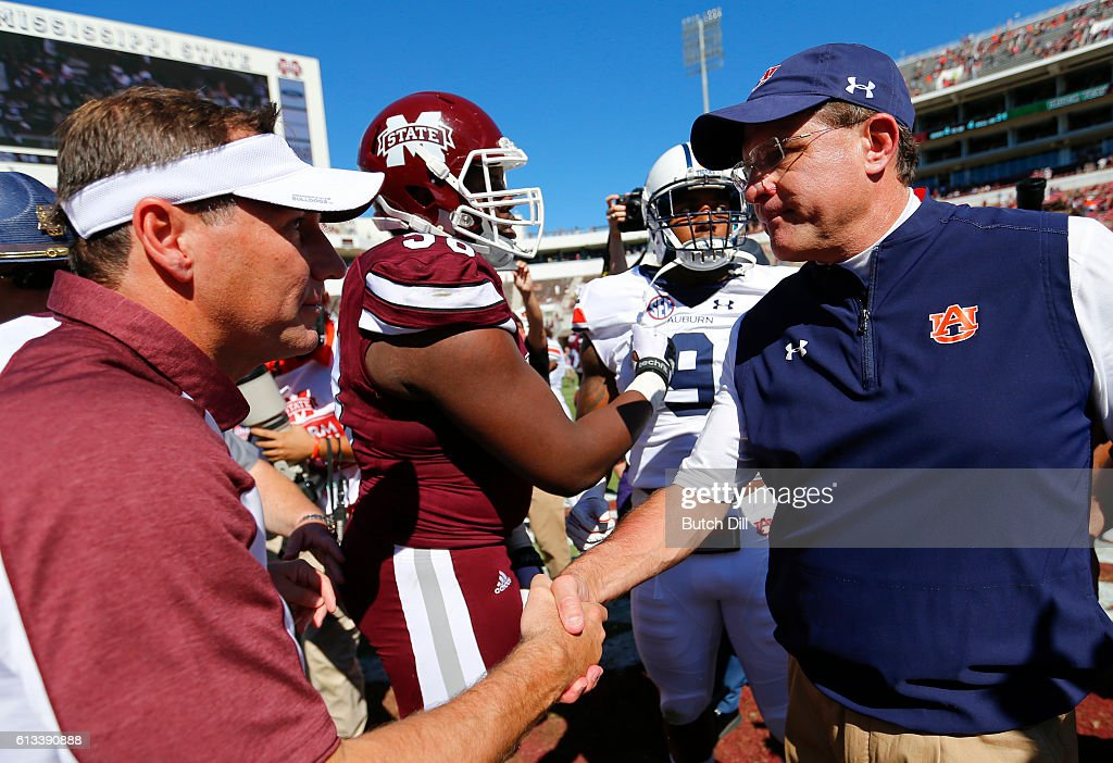 Mississippi State Bulldogs coach Dan Mullen (left) shakes hands with Auburn Tigers coach Gus Malzahn after an NCAA college football game on October 8, 2016 in Starkville, Mississippi. Auburn won 38-14.
