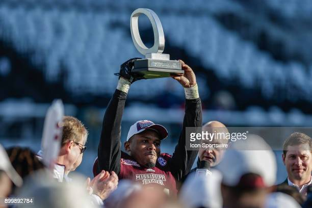 Mississippi State Bulldogs defensive back Mark McLaurin with the Most Valuable Player trophy following the game between the Louisville Cardinals and...