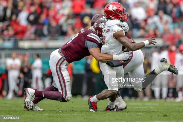 Mississippi State Bulldogs defensive lineman Montez Sweat pressures Louisville Cardinals quarterback Lamar Jackson during the game between the...