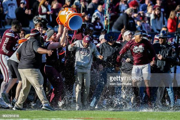Mississippi State Bulldogs interim head coach Greg Knox gets a Gatorade dunk during the game between the Louisville Cardinals and the Mississippi...