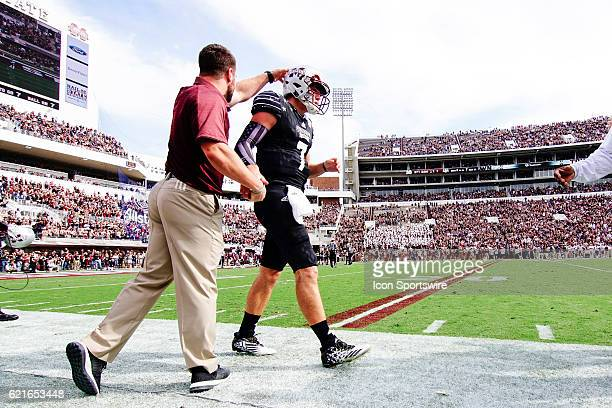 Mississippi State Bulldogs quarterback Nick Fitzgerald is congratulated on the sideline after a touchdown pass during the football game between...