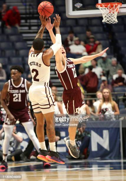 Mississippi State guard Lamar Peters shoots a 3pointer over Texas AM guard Chris Collins during a Southeastern Conference Tournament game between the...