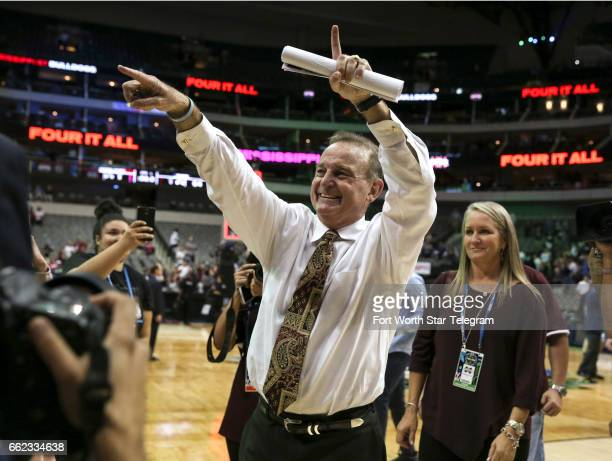 Mississippi State head coach Vic Schaefer gestures to fans as he leaves the court after a 6664 win against Connecticut in an NCAA Tournament...