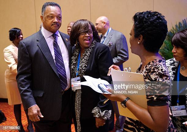 Mississippi State Rep. Mary Coleman , poses for a photo with Civil rights activist Rev. Jesse Jackson on December 6, 2012 before the opening plenary...