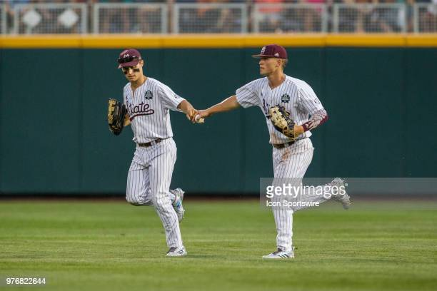 Mississippi State's Jake Mangum and Mississippi State's Elijah MacNamee fist bump while running back to the dugout in the game against Washington...