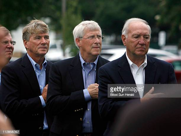 Mississippi US Representative Gene Taylor from left Mississippi US Senator Roger Wicker Biloxi Mayor AJ Holloway stand at attention during National...