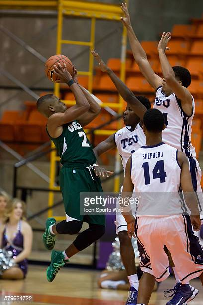 Mississippi Valley State Delta Devils guard Jordan Washington attempts a shot over several TCU Horned Frogs players during the NCAA basketball game...