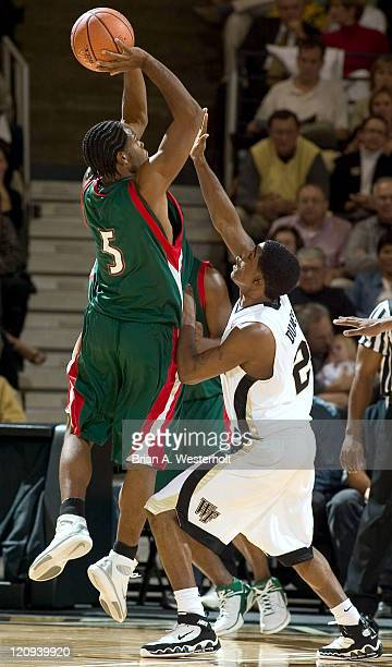 Mississippi Valley State guard Stanford Speech shoots over Wake Forest guard Shamaine Dukes during first half action in the 2K Sports College Hoops...