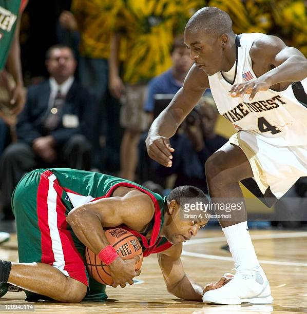 Mississippi Valley State's Tychicus Snow covers up a loose ball as Wake Forest's Harvey Hale defends during second half action in the 2K Sports...