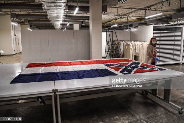 Mississippi's flag from the state's capitol is kept on a table for showcase at the Mississippi Department of Archives and History in Jackson...