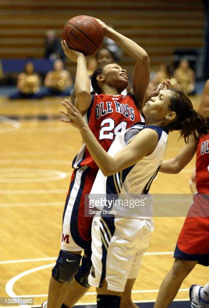 Mississippi's Latanya Jones drives on Pittsburgh's Mallorie Winn during second round action of the WNIT at the Fitzgerald Field House on March 22...