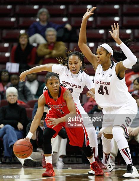Mississippi's Valencia McFarland feels pressure from South Carolina's Alaina Coates and Olivia Gaines during the first half at Colonial Life Arena in...