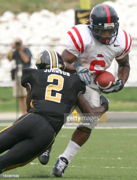 Missouri defenisve back Domonique Johnson tackles Ole Miss running back BenJarvus Green-Ellis during the game between the Mississippi Rebels and the...