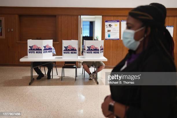 Missouri Democratic congressional candidate Cori Bush arrives to cast her vote on August 4, 2020 at Gambrinus Hall in St Louis, Missouri. Bush, an...