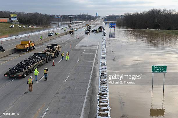 Missouri Department of Transportation workers and members of the Missouri National Guard work along Interstate 55 on December 31 2015 in Arnold...