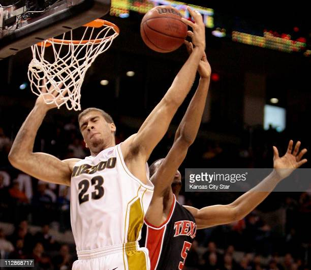 Missouri forward Justin Safford grabbed a board from Texas Tech forward D'Walyn Roberts during a Big 12 men's basketball tournament game at the Ford...