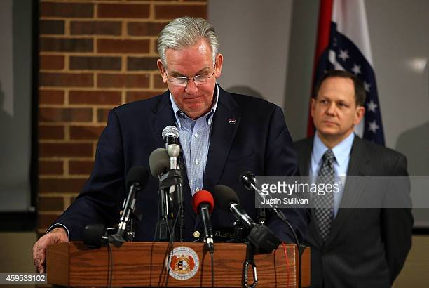 Missouri Gov Jay Nixon pauses while speaking during a news conference as St Louis mayor Francis Slay looks on at the University of Missouri St Louis...