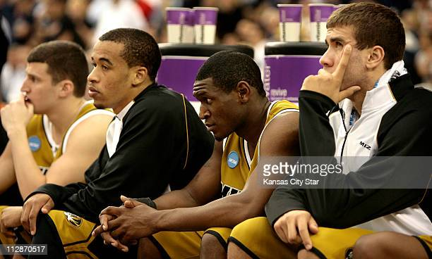 Missouri guard Matt Lawrence forward Laurence Bowers guard JT Tiller and forward Justin Safford watch the final seconds of the game as the Tigers...