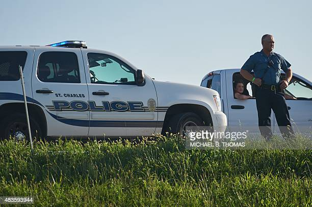 A Missouri Highway Patrol Trooper surveys the scene during a civil disobedience action August 10 2015 on US Interstate 70 in Earth City Missouri St...