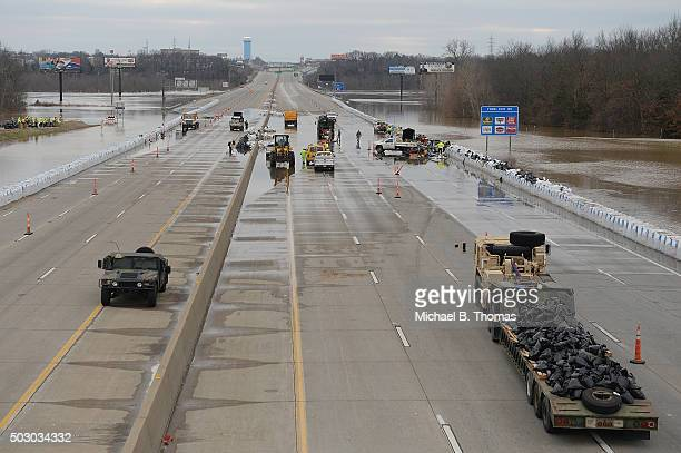 Missouri National Guard equipment sits along Interstate 55 on December 31 2015 in Arnold Missouri The highway has been closed since December 30th as...