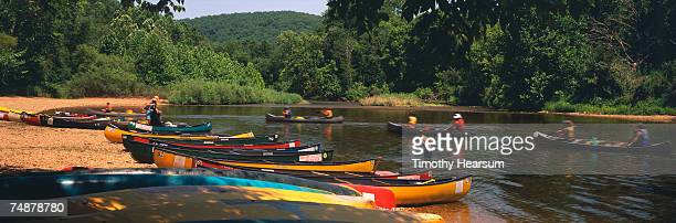 usa, missouri, ozarks, near van buren, people in canoes - ozark mountains stock pictures, royalty-free photos & images