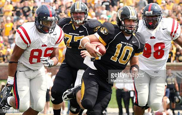 Missouri quarterback Chase Daniel runs for a first down against Ole Miss during the game between the Mississippi Rebels and the Missouri Tigers at...