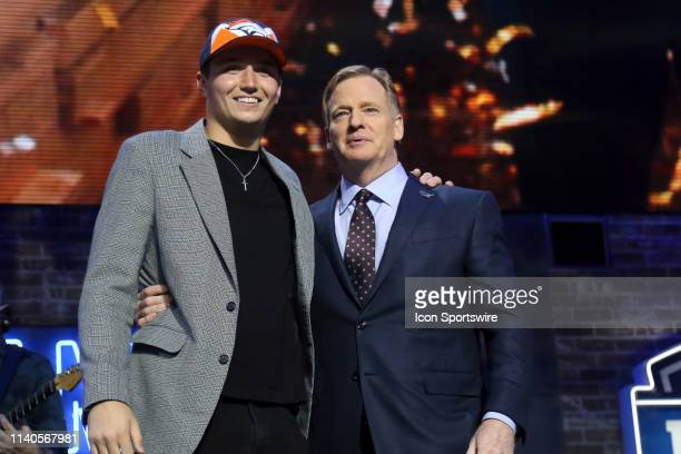 Missouri quarterback Drew Lock and NFL Commissioner Roger Goodell during the second round of the 2019 NFL Draft on April 26 at the Draft Main Stage...