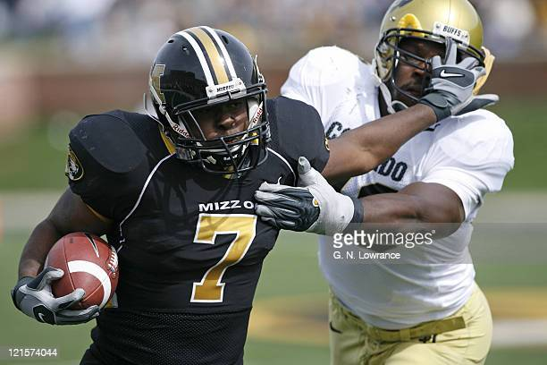 Missouri running back Earl Goldsmith fights off a defender during action between the Colorado Buffaloes and Missouri Tigers at Faurot Field in...