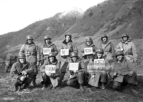 Missouri soldiers from the 19th Infantry Regiment pose for a group portrait, along the Kumsong front, to wish folks back home a Happy New Year,...