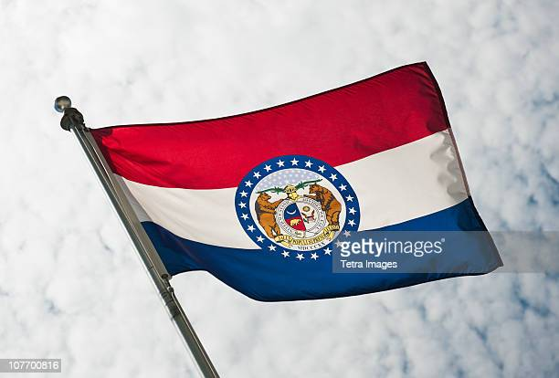 usa, missouri state flag against sky - missouri stock pictures, royalty-free photos & images