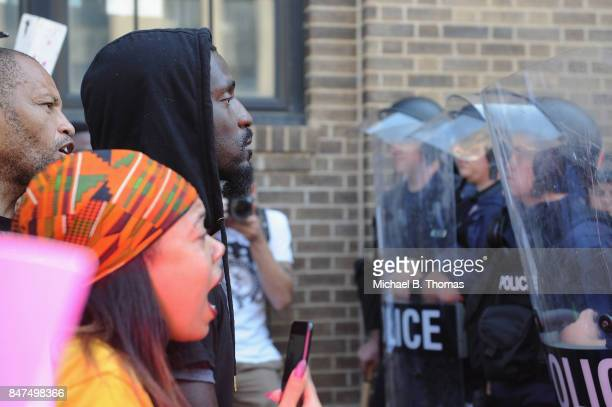 Missouri State Representative Bruce Franks stands before police in riot gear as protestors demonstrate following a not guilty verdict on September 15...