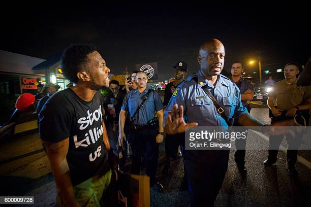 Missouri State Trooper Captain Ronald Johnson gets an ear full from a protester as he tries to calm down the tensions after days of heavy and...