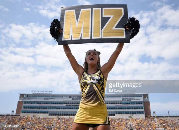 Missouri Tigers cheerleader pumps up the crowds during a game against the Missouri State Bears in the fourth quarter at Memorial Stadium on September...