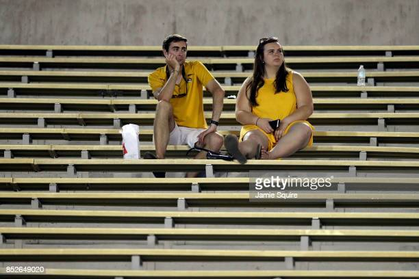 Missouri Tigers fans watch from empty bleachers late during the game against the Auburn Tigers at Faurot Field/Memorial Stadium on September 23, 2017...