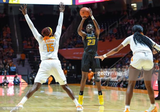 Missouri Tigers guard Amber Smith takes a shot over Tennessee Lady Volunteers forward Cheridene Green during a college basketball game between the...