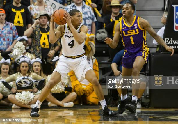 Missouri Tigers guard Javon Pickett looks to pass the ball around the defense of LSU Tigers guard Ja'vonte Smart during the SEC conference game...