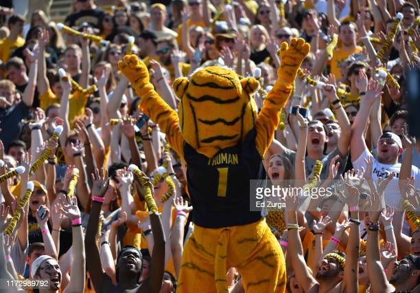 Missouri Tigers mascot Truman the Tiger entertains fans during a game against the West Virginia Mountaineers in the first quarter at Faurot...