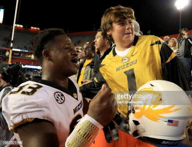 Missouri Tigers players celebrate with fans following a 3817 victory over the Florida Gators at Ben Hill Griffin Stadium on November 3 2018 in...