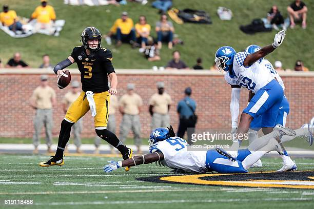 Missouri Tigers quarterback Drew Lock is flushed out of the pocket during a NCAA football game between the Kentucky Wildcats and the Missouri Tigers...