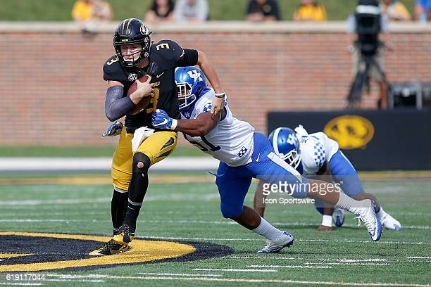 Missouri Tigers quarterback Drew Lock is tackled by Kentucky Wildcats linebacker Courtney Love as he runs the ball during the second half of a NCAA...