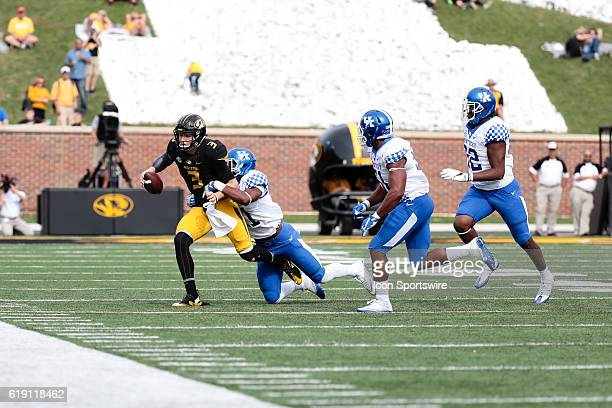Missouri Tigers quarterback Drew Lock is tackled while scrambling with the ball during a NCAA football game between the Kentucky Wildcats and the...